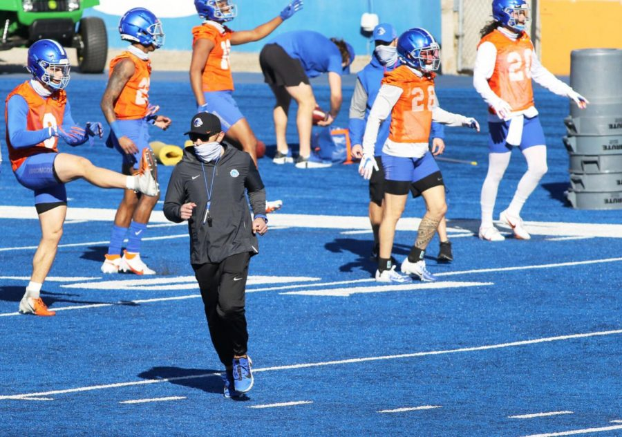 Boise State head football coach Andy Avalos jogs across the field during spring football practice on March 21.