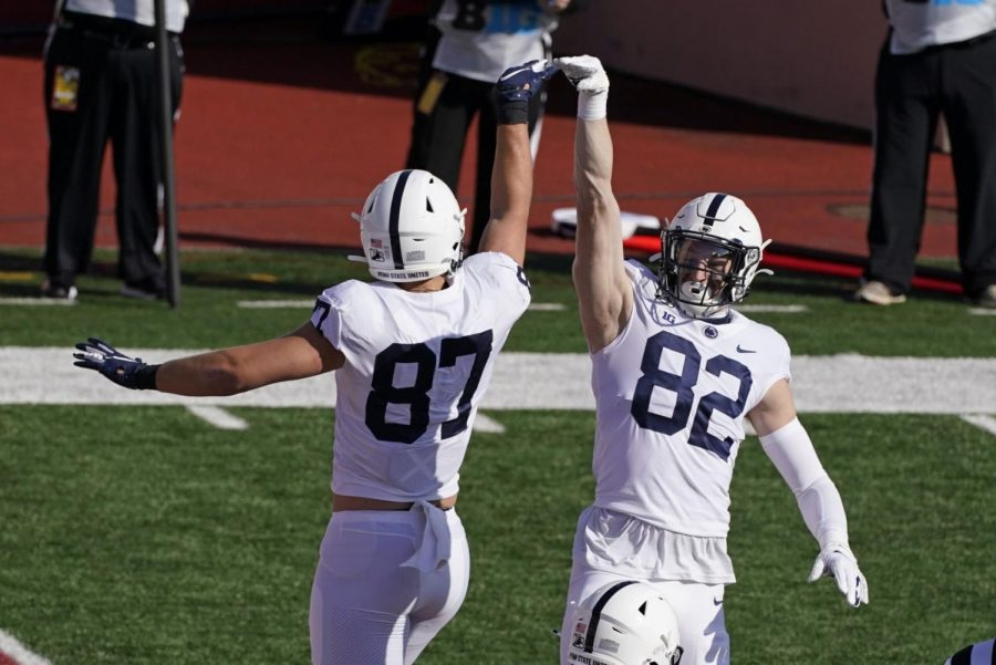 Penn State's Zack Kuntz, right, andPat Freiermuth celebrate a touchdown Freiermuth during the first half of an NCCAA college football game against Indiana Oct. 24, 2020, in Bloomington, Ind.