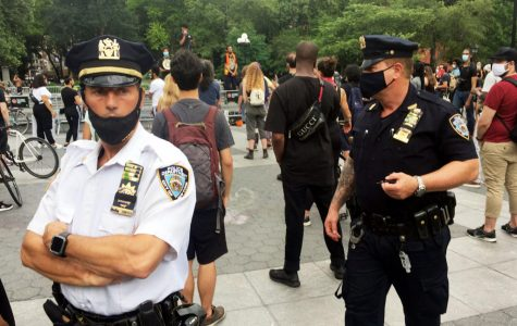 New York Police Department officers stand nearby July 7, 2020, as Black Lives Matter Protests continue in New York City.