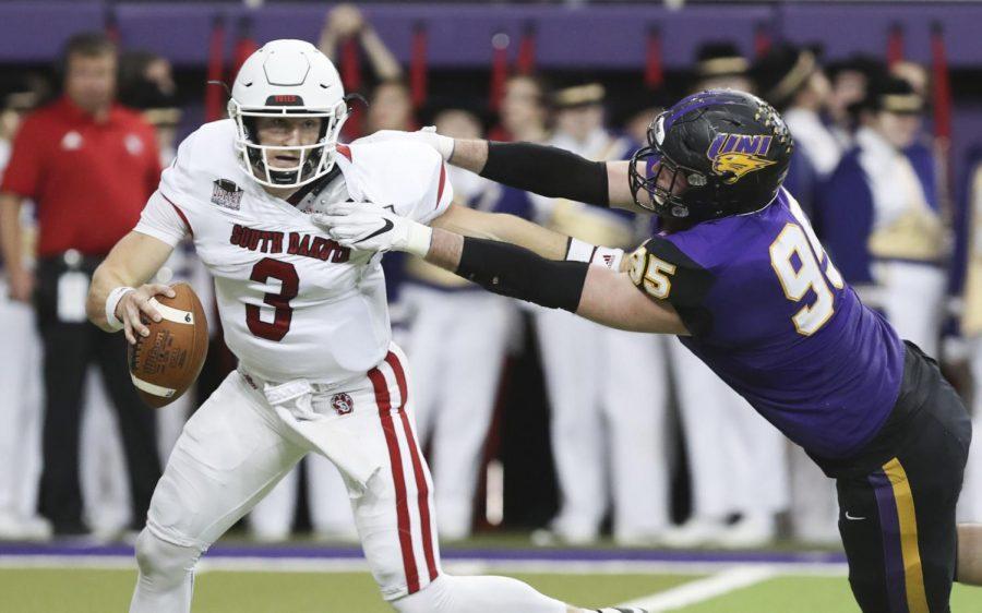 UNI's Seth Thomas tries to sack South Dakota quarterback Austin Simmons during a 2019 game in the UNI-Dome.