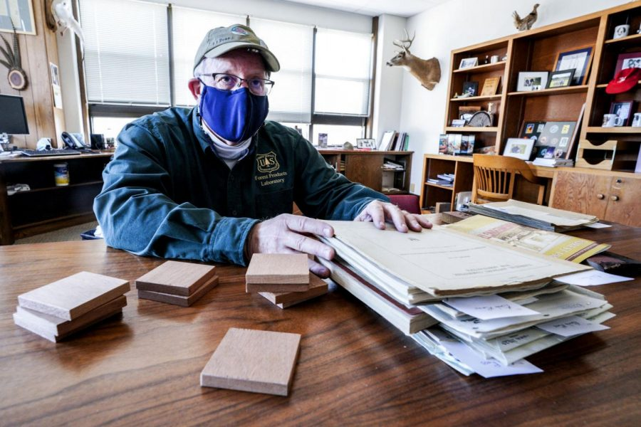 Bob Ross, a wood scientist with the Forest Products Laboratory, with samples of mahogany left over from a World War I study that will be used to restore parts of the U.S. Capitol damaged in the Jan. 6 insurrection.