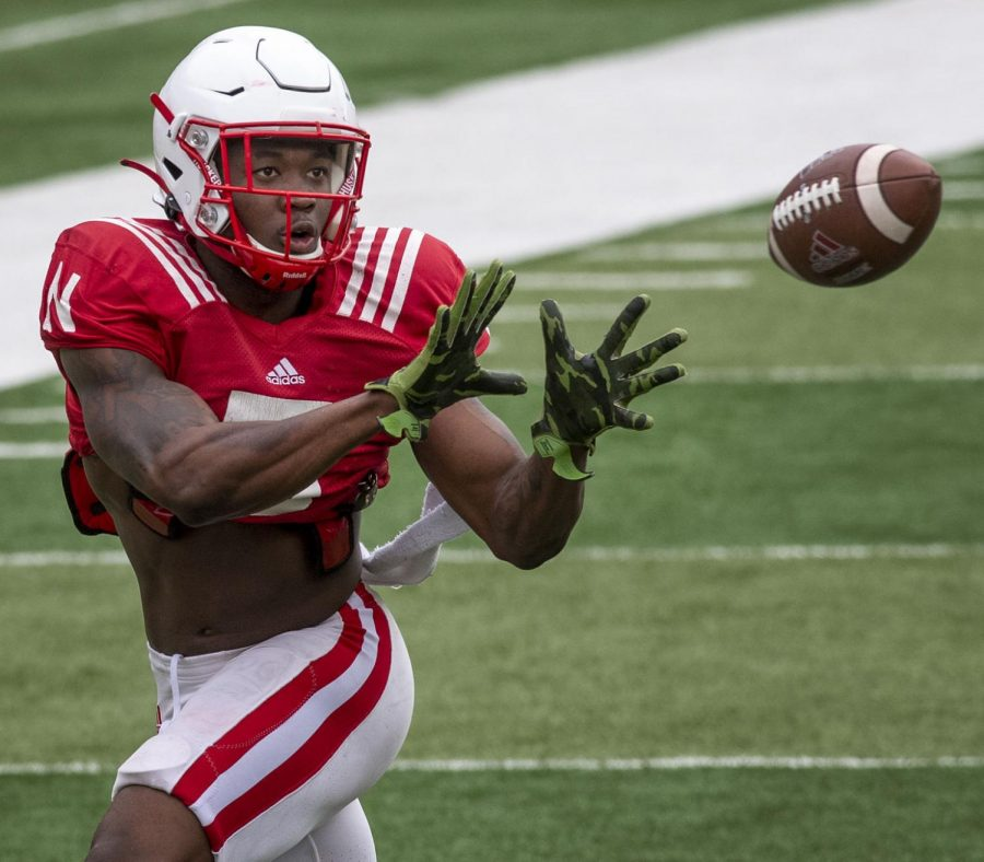 Nebraska wide receiver Omar Manning catches a pass Saturday during a football practice at Memorial Stadium.