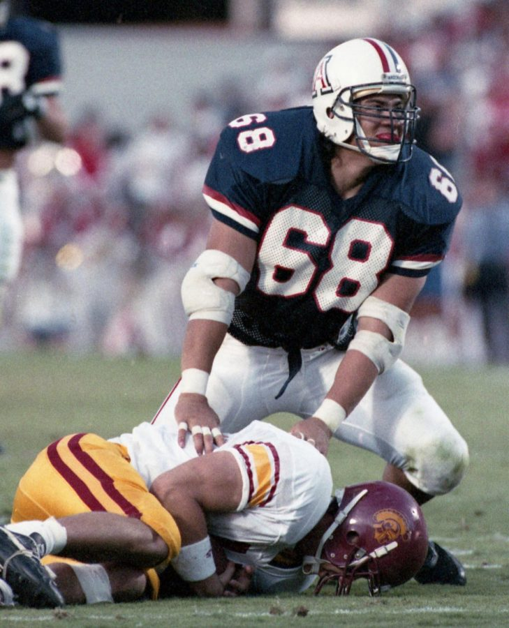 Arizona defensive end Tedy Bruschi downs USC quarterback Rob Johnson during Arizona Wildcats vs. USC in Tucson on Oct. 22, 1993. Arizona won, 38-7.