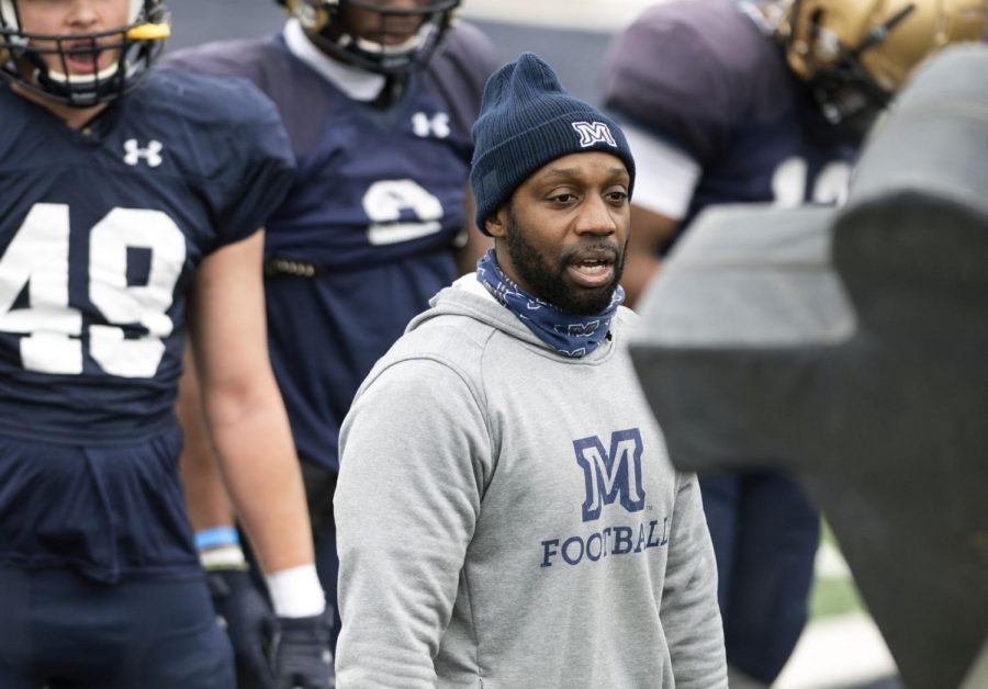 Montana State running backs coach Jimmy Beal directs drills March 27 at Bobcat Stadium.