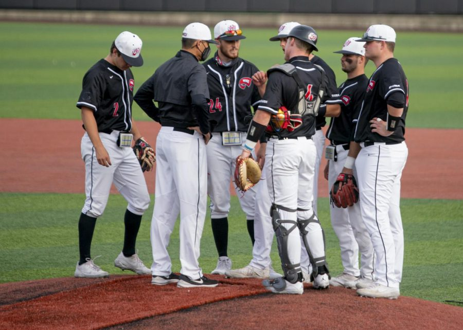 Head coach John Pawlowski and his infield conduct a mound visit with pitcher Jake Kates against Middle Tennessee on Friday, April 16, 2021.