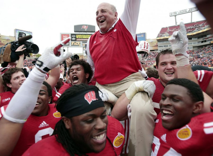 Players lift interim head coach Barry Alvarez onto their shoulders after their victory over Auburn in the Outback Bowl on Jan. 1, 2015, in Tampa, Fla. Alvarez, then UWs athletic director, agreed to coach in the game after Gary Andersen quit a month earlier.