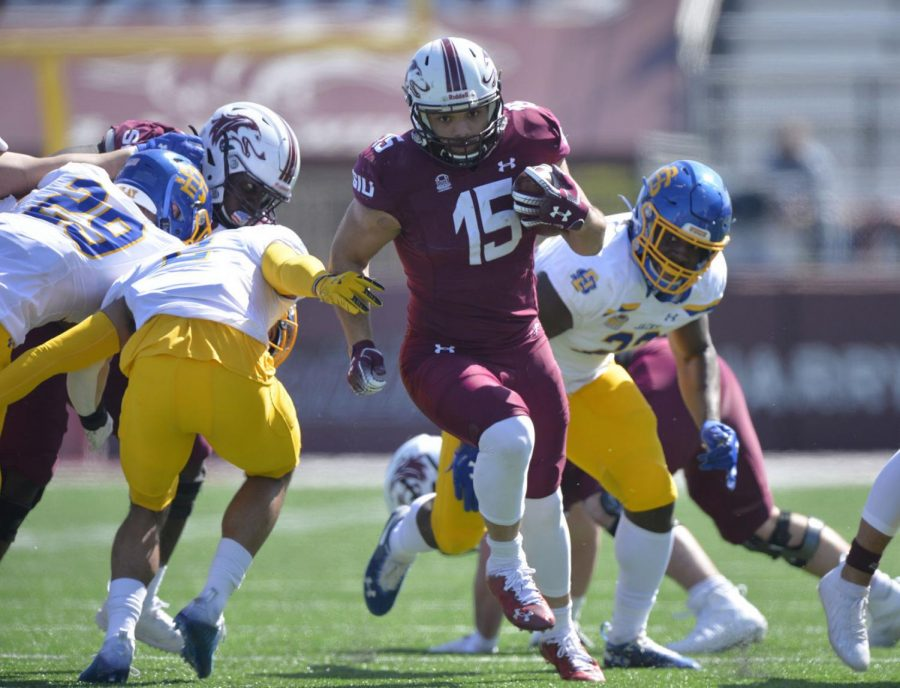 SIU running back Javon Williams Jr. (15) looks for running room against South Dakota State during the third quarter at Saluki Stadium on March 20 in Carbondale. SIU went on to lose 44-3.