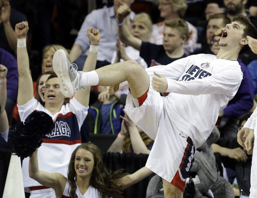 Gonzaga's Rem Bakamus reacts on the bench as Gonzaga scores against North Dakota State during the second half of an NCAA tournament college basketball game in the Round of 64 in Seattle, Friday, March 20, 2015.