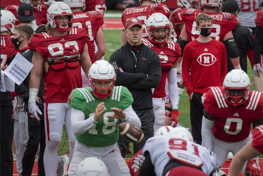 Nebraska head coach Scott Frost (top center) watches the action on Saturday during a practice at Memorial Stadium. Walk-on QB Matt Masker prepares to haul in a snap from center.