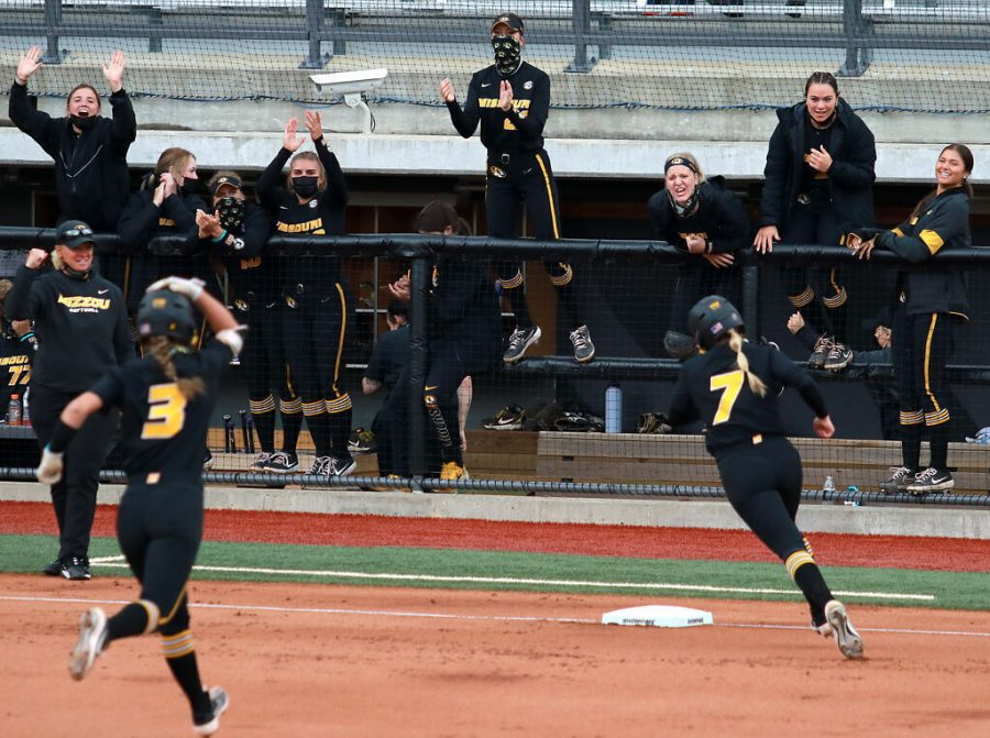 Missouri+softball+players+cheer+from+the+dugout+while+freshman+Jenna+Laird+and+senior+Brooke+Wilmes+round+the+bases+after+a+home+run+Saturday+at+the+Mizzou+Softball+Stadium+in+Columbia.+Laird+hit+home+runs+in+consecutive+innings+for+the+Tigers%2C+who+won+both+of+their+games+against+Mississippi+State+on+Saturday.