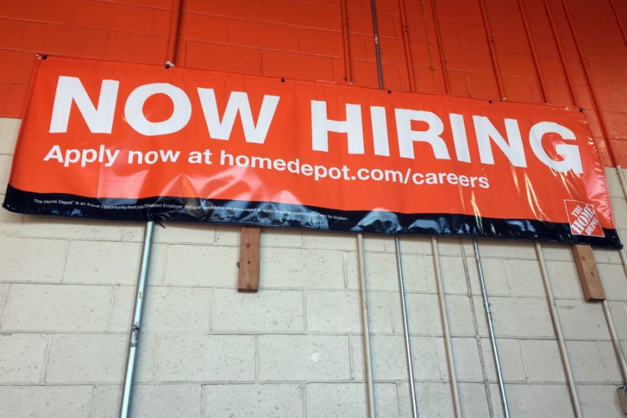 FILE - Now Hiring sign, unemployment, jobs