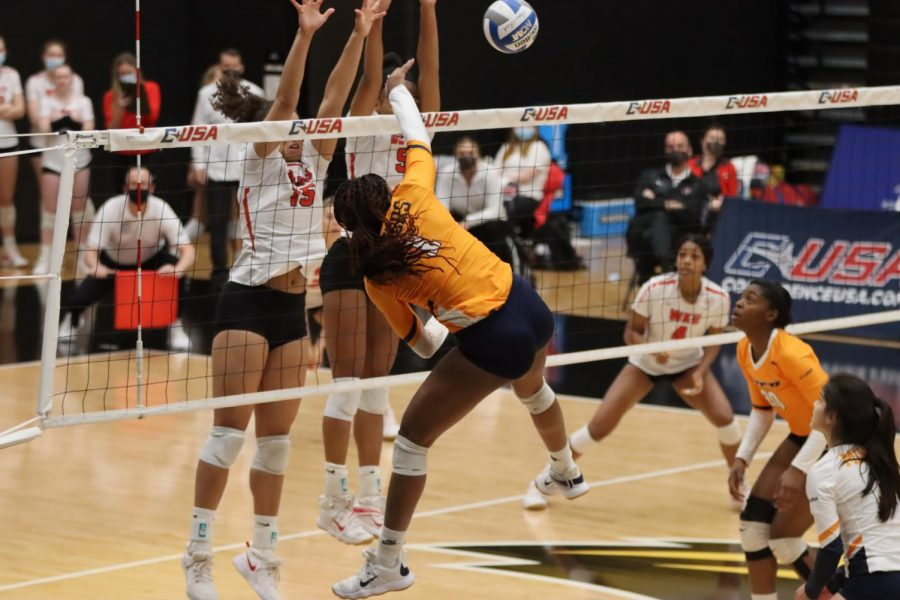 Senior Kayland Jackson (15) and junior Lauren Matthews (5) going up for a block on April 2, 2021 against UTEP. WKU swept the set 3-0 against the Miners to advance the C-USA Championship match.