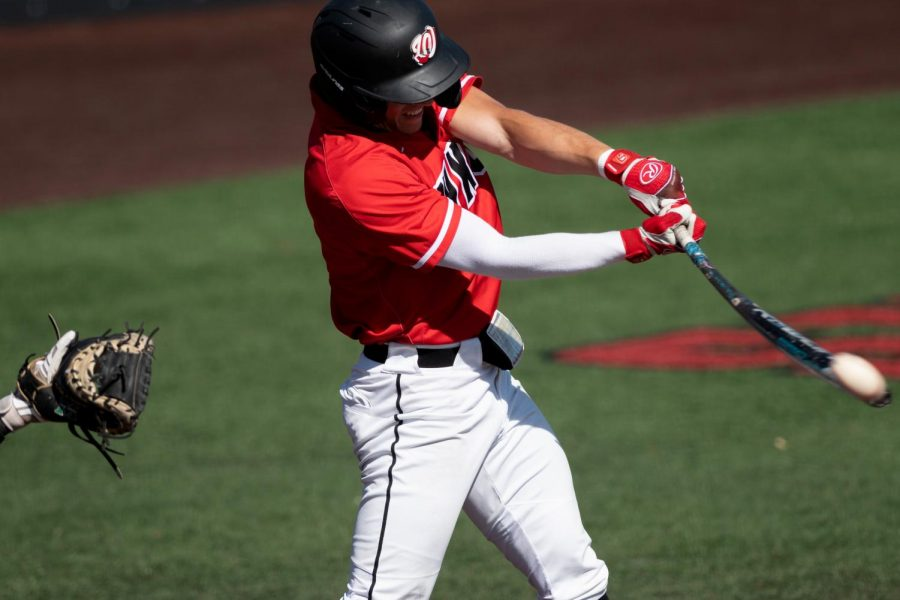 WKU Junior Justin Carlin attempts to put the ball in play during a game against Marshall College on April 11, 2021.