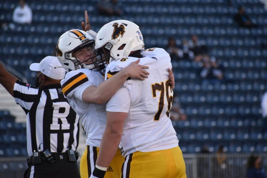 Wyoming kicker John Hoyland celebrates with teammate Justis Borton after kicking a field goal against Nevada on Oct. 24, 2020, at Mackay Stadium in Reno, Nev. Hoyland, a former walk-on, has been placed on scholarship.