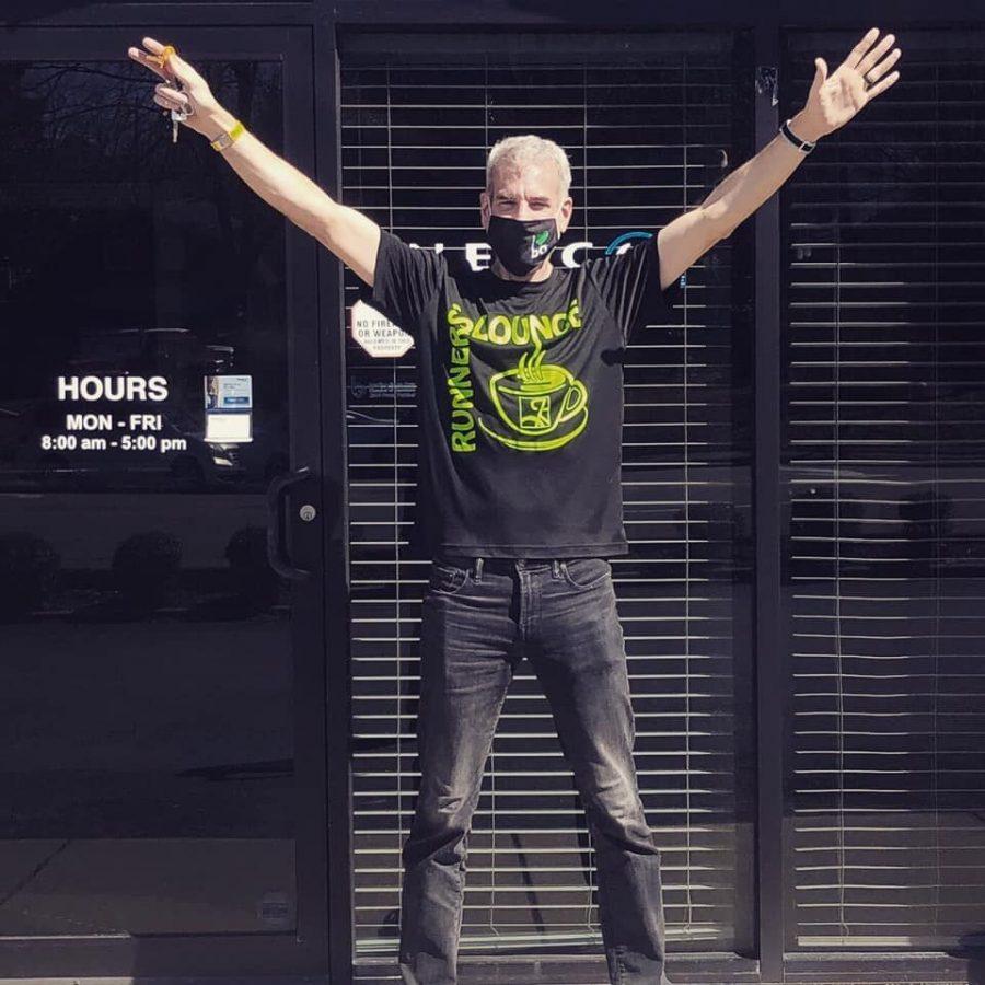 Patrick Folker stands outside the Runner's Lounge (via Runner's Lounge Facebook)