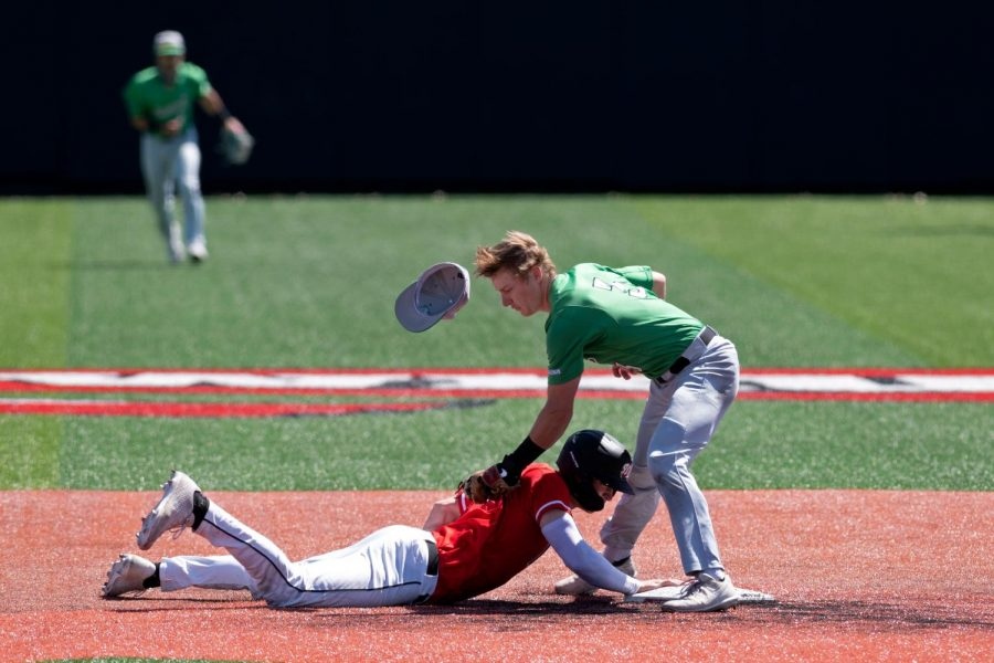 WKU sophomore outfield Jackson Gray dives back to second base to avoid being picked-off during a game against Marshall College on April 11, 2021.