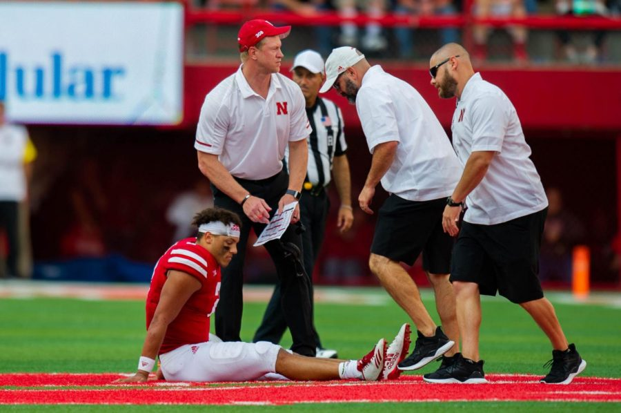 Nebraska quarterback Adrian Martinez is attended to after going down with an injury against Colorado on Sept. 8, 2018, at Memorial Stadium.