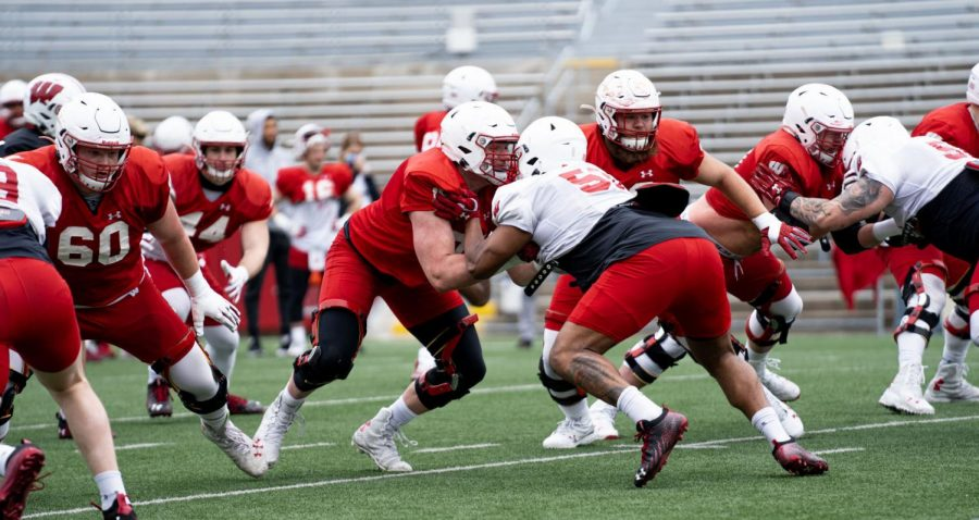 UW redshirt freshman Jack Nelson, center, blocks during Saturday's spring practice. The Stoughton product appears to have the physical tools needed to start at guard for the Badgers, but he's still learning the mental side of the position.