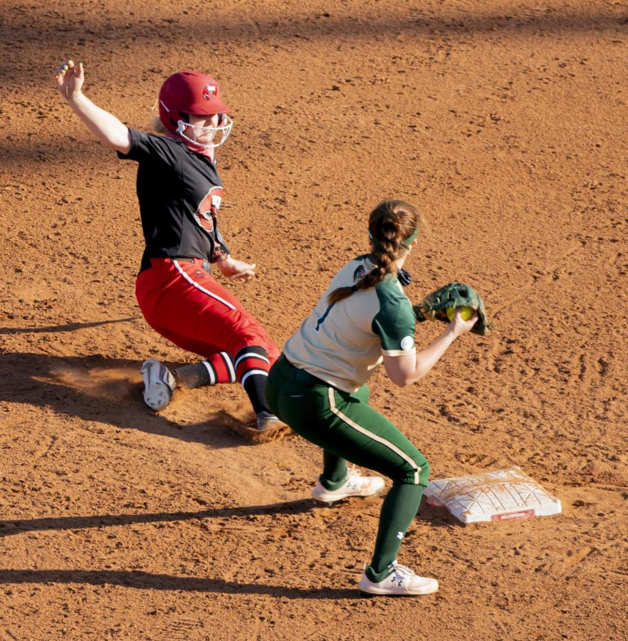 WKU utility player, Jordan Ridge (9) breaks up a double play during the game against UAB Saturday, March 20, 2021.