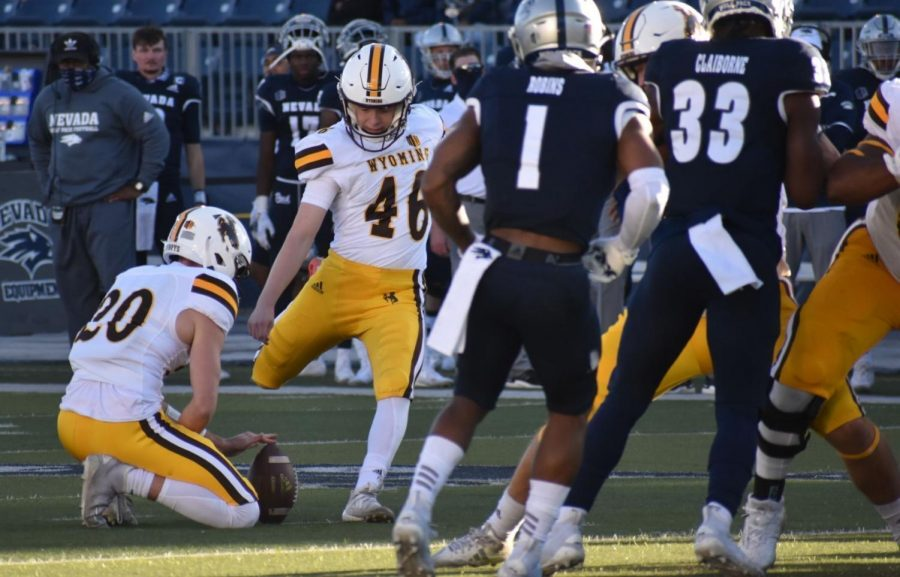 Wyoming's John Hoyland kicks against Nevada on Oct. 24, 2020, at Mackay Stadium in Reno, Nev. The Cowboys' freshman emerged last season to secure the placekicking job, but UW has to replace some of its other specialists.