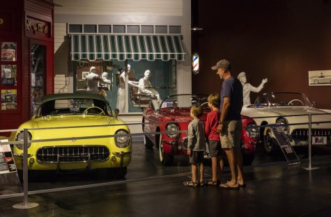 An exhibit of the National Corvette museum featuring two Corvettes made during the 1950
