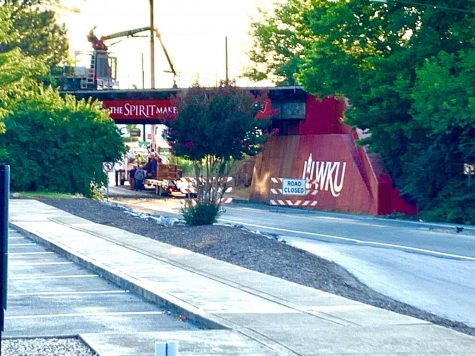 CSX Railroad workers begin working on the rail bridge over Russellville Road, which will result in nightly detours for several days. /HERALD