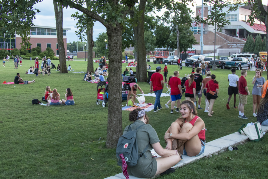 Students sit outside on South Lawn during Topper Fest on Friday, Aug. 20, 2021.