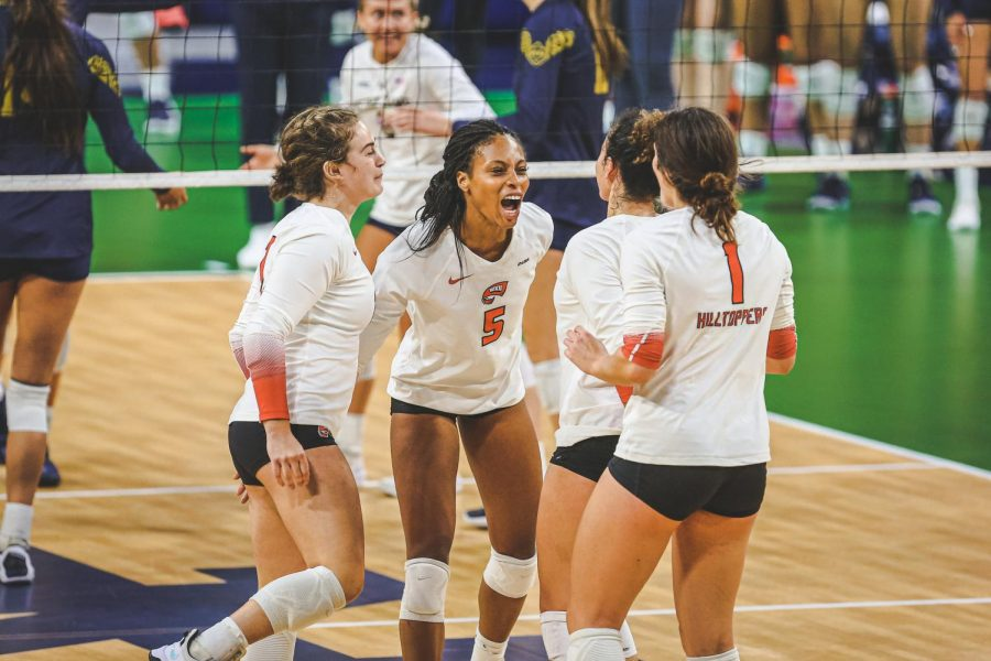 WKU middle hitter Lauren Matthews (5) celebrates with her teammates during WKUs victory over Notre Dame on Aug. 27, 2021. Matthews reached the 1,000 kills milestone during the match.