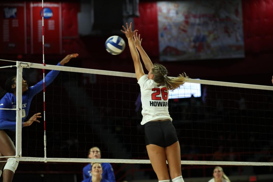 Freshman outside hitter Katie Howard makes a play during the Hilltoppers exhibition match against the Kentucky Wildcats on Aug. 19, 2021 in E. A. Diddle Arena.
