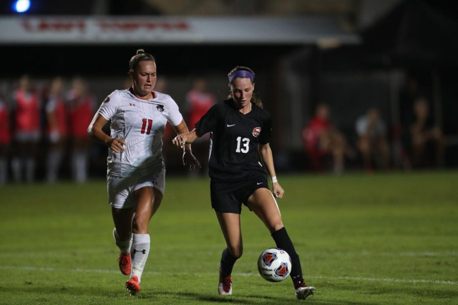 Junior forward Katie Erwin keeps the ball away from a defender during the Hilltoppers season opener against Austin Peay on Aug. 19, 2021. Erwin would score a goal and provide an assist during the match.