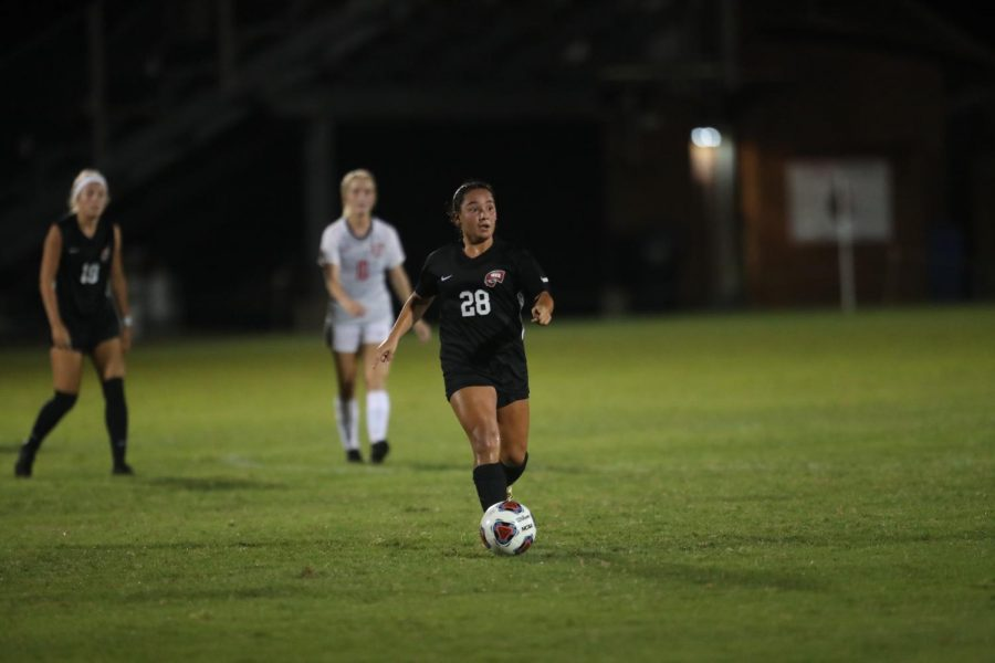 Freshman+midfielder+Briana+Sayoc+looks+for+an+open+teammate+during+WKUs+game+against+Union+University+on+Aug.+21%2C+2021+at+the+WKU+Soccer+Complex.