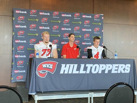 Offensive lineman Mason Brooks (left), offensive coordinator Zach Kittley (center) and quarterback Bailey Zappe (right) field questions from reporters during WKU