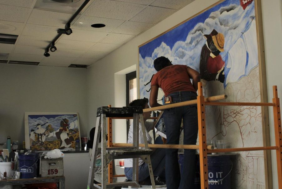 Alice Gatewood Waddell is currently working on a Jonesville mural in the lobby of the Kentucky Museum. The mural depicts the story of the thriving neighborhood as WKU takes over the land.