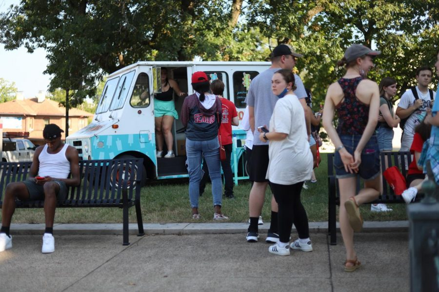 Students line up at PopWorks ice cream truck for popsicles at the PCAL Welcome Back Bash on Monday, Aug. 23.