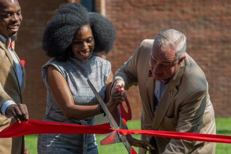 In the morning of Aug. 28, 2021, President Caboni excitedly cuts the ribbon recognizing The Jonesville Academy's establishment on Western Kentucky University's campus while Tyreon Clark holds the ribbon cutting with students assisting on both sides.