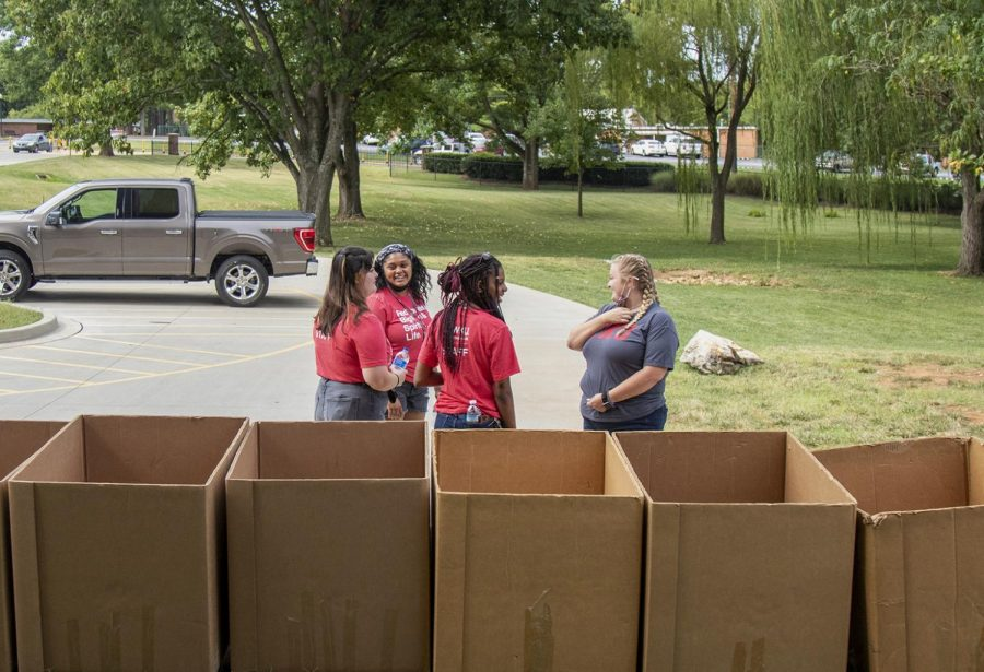 WKU community advisor Brianna Wright, and resident advisors Victoria Branch, Calysta Fuller and Syrenity Smith set up boxes to aid freshman moving into Pearce Ford Tower.