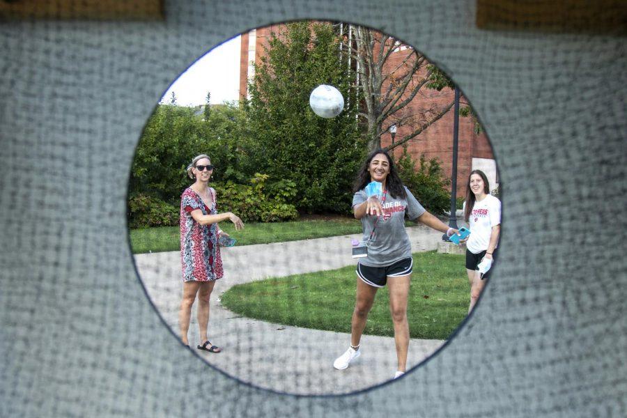 Western Kentucky University senior Meral Abdelgawald toss a football into a net during Topper Fest on Friday evening.