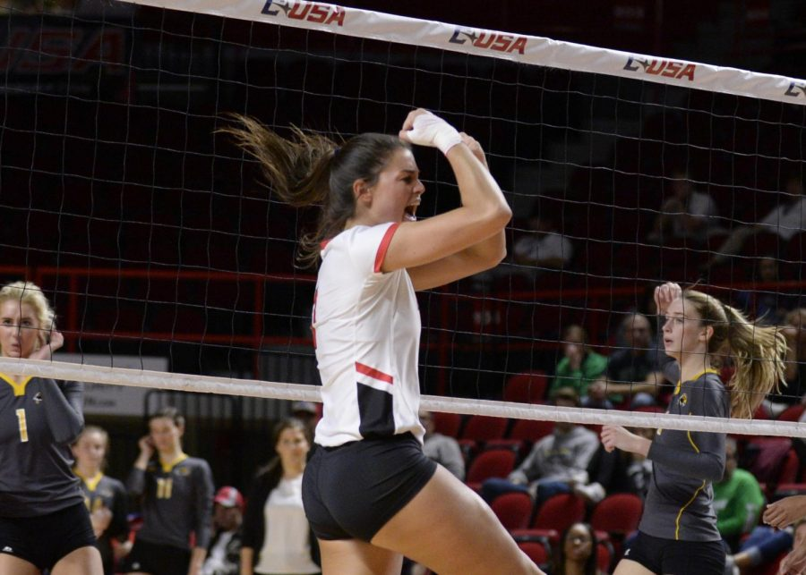 WKU Volleyball great Alyssa Cavanaugh celebrates during a set against Southern Miss.