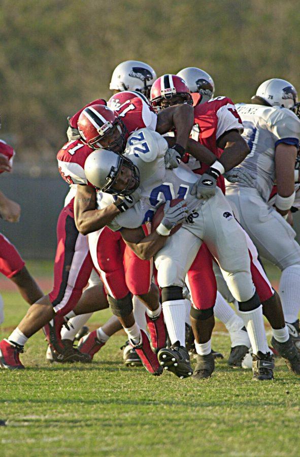Sherrod Coates makes a tackle during his illustrious WKU career.