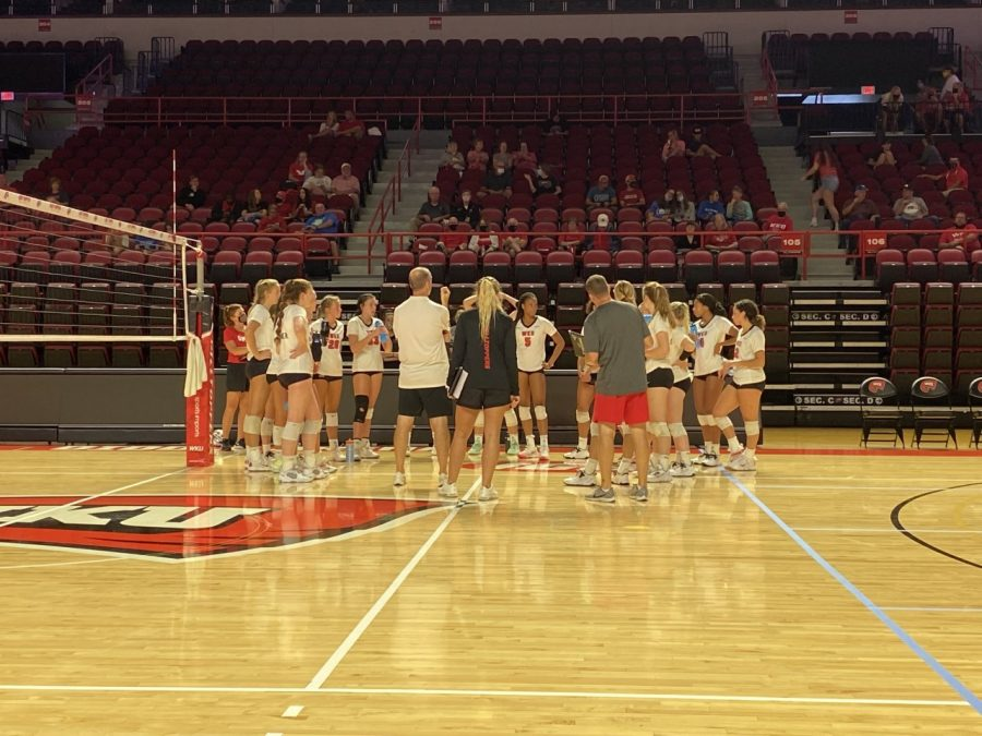 Head coach Travis Hudson talks with the WKU volleyball team during its intrasquad scrimmage on Aug. 14, 2021 at Diddle Arena.