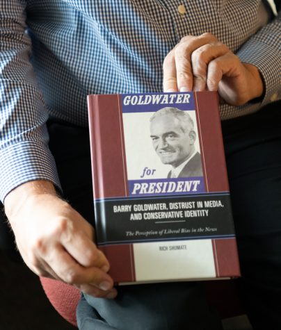 """Dr. Rich Shumate poses holding his new book, """"Goldwater for President,"""" in his office on the second floor of WKUs Jody Richards Hall."""