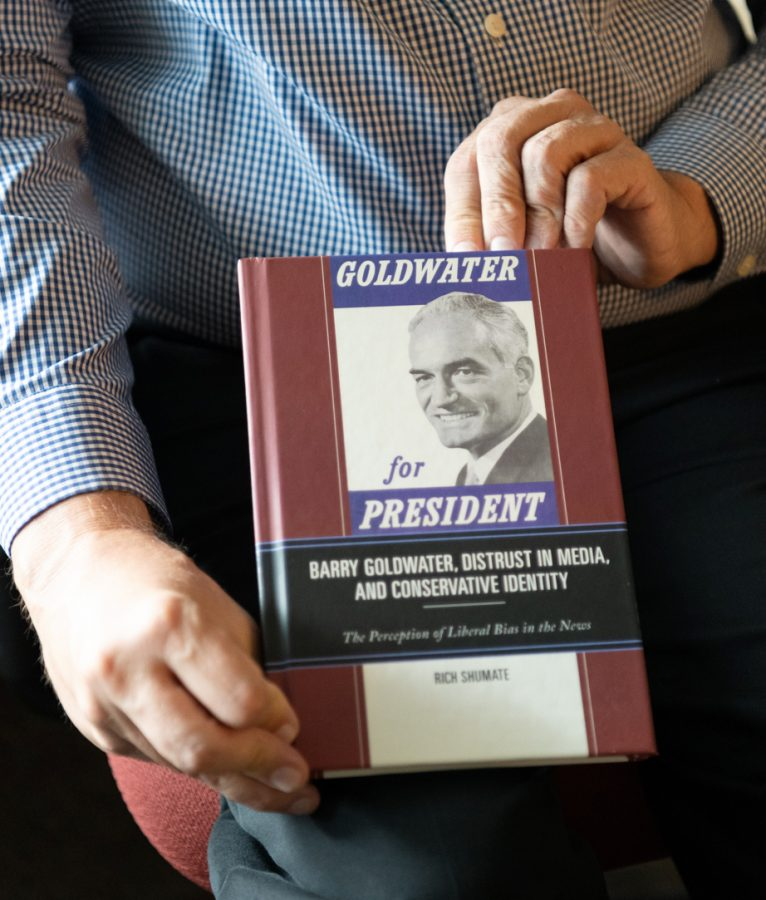 """Dr. Rich Shumate poses holding his new book, """"Goldwater for President,"""" in his office on the second floor of WKU's Jody Richards Hall."""