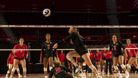WKU defensive specialist Ashely Hood (11) jumps to save the ball during the match against St. John's University at Diddle Arena on Sept. 18, 2021.