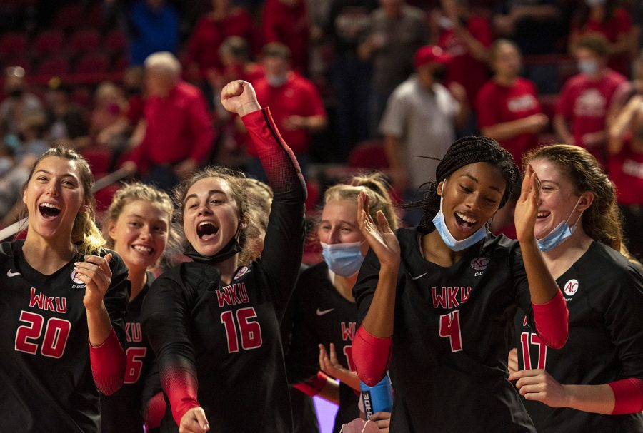 The WKU volleyball team celebrates after winning the match against St. John's University at Diddle Arena on Sept. 18, 2021.