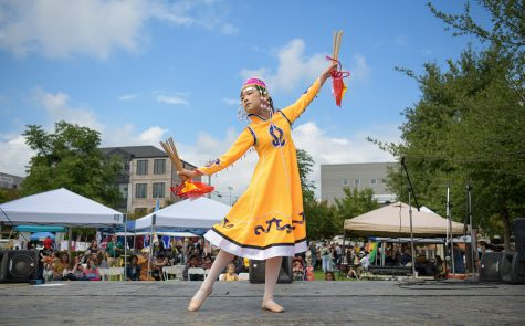 A young student of Cheryl Pan, a traditional Chinese dance instructor, performs on stage in Circus Square Park, Saturday, Sept. 25, 2021, for the Bowling Green International Festival.