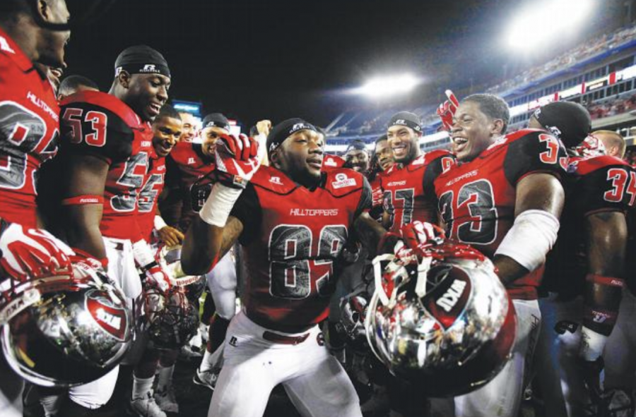 WKU+sophomore+wide+receiver+Stephon+Brown+dances+in+a+circle+of+his+teammates+while+celebrating+WKU%E2%80%99s+win+over+the+Kentucky+Wildcats+at+LP+Field+in+Nashville%2C+Tennessee.