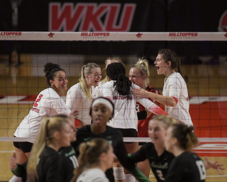 The WKU Hilltoppers celebrate after a point against the Marshall Thundering Herd on the evening of Sept. 24, 2021 during their volleyball match in Diddle Arena.
