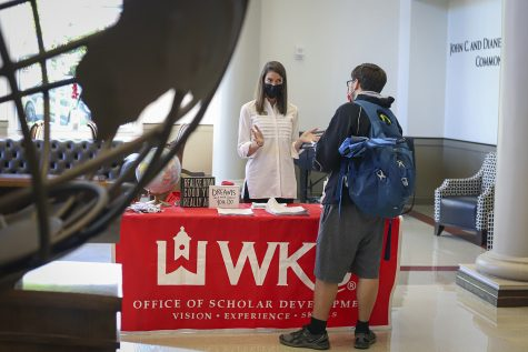 Lindsey Houchin, WKU's coordinator of nationally competitive opportunities, informs a student of scholarships available for the WKU Study Abroad program at the annual Fall Study Abroad Fair on Tuesday, Sept. 14, 2021.