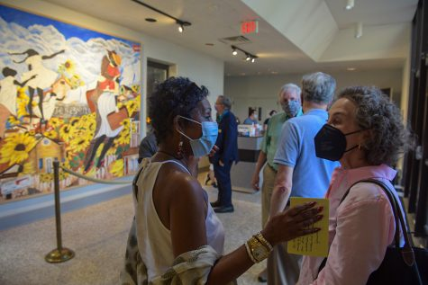 Artist Alice Gatewood Waddell (center) visits with an attendee of an artists talk for the fresco mural (pictured left) of Jonesville that she designed on Thursday, Sept. 16, 2021, at WKU's Kentucky Museum.