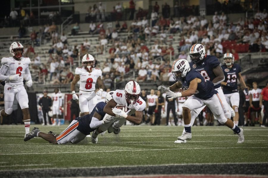 WKU wide receiver Mitchell Tinsley (5) battles for extra yardage to get the Hilltoppers in scoring range. The Hilltoppers defeated the Skyhawks 59-24 in their season opener on September 2, 2021 at Houchins-Smith Stadium.